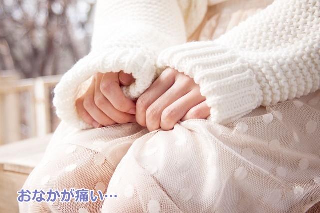 白いセーターを着た人